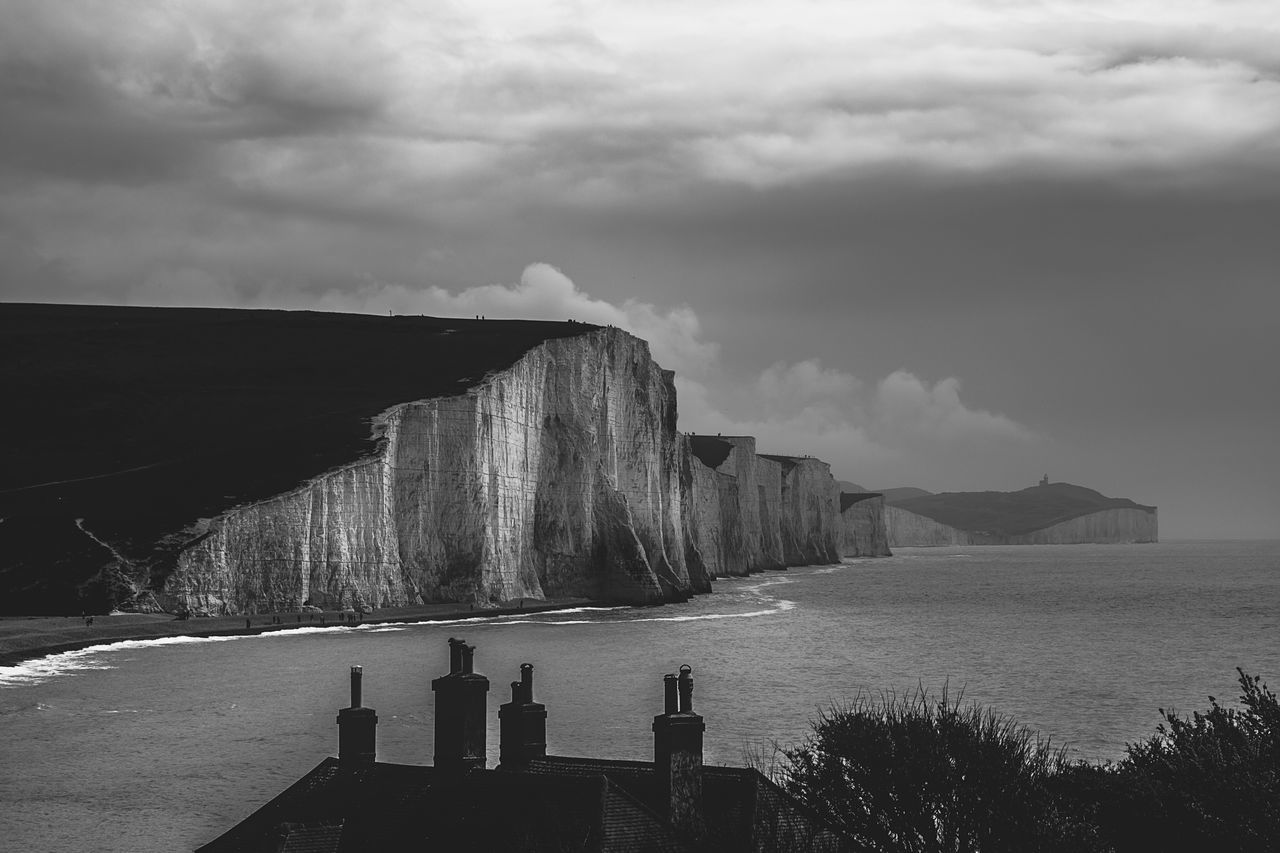 Sky Nature Cloud - Sky Water Day Beauty In Nature Outdoors Tranquil Scene Tranquility Sea No People Scenics Built Structure Architecture Mountain Hydroelectric Power Blackandwhite Beachy Head Black And White Beach Pebble Beauty In Nature Seven Sisters Nature Tranquility