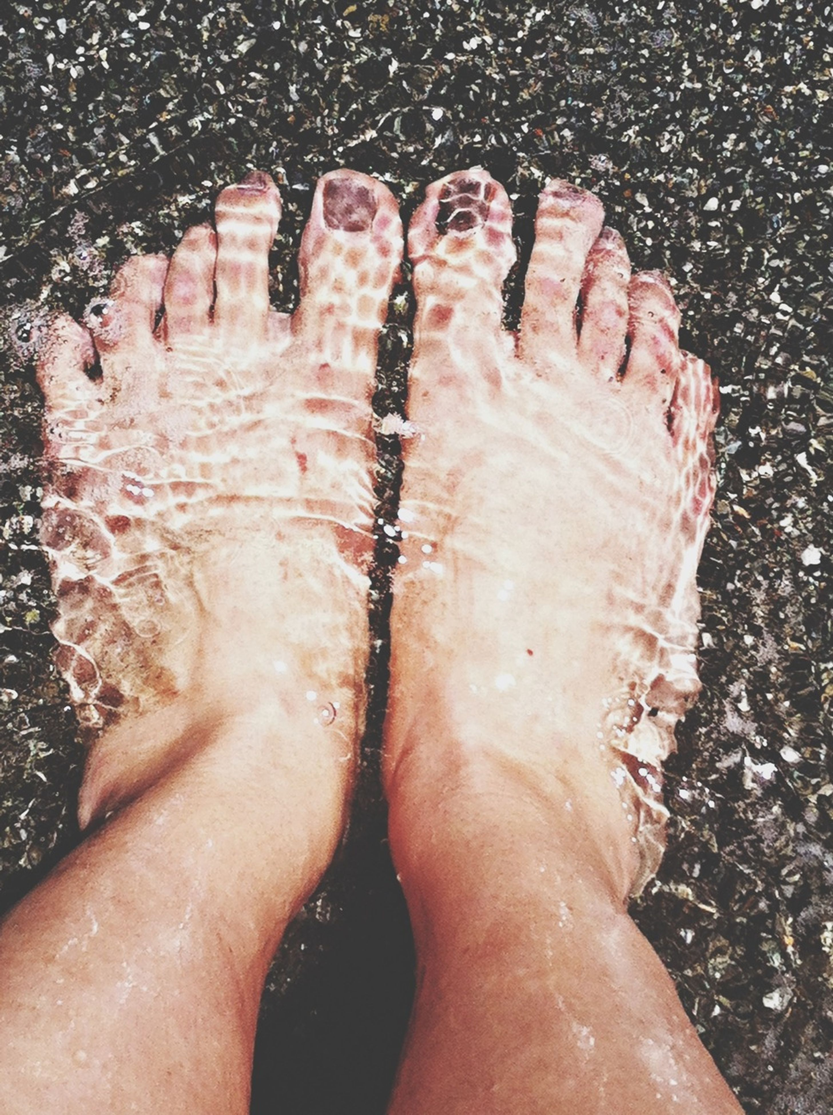 person, low section, water, wet, barefoot, beach, human foot, lifestyles, personal perspective, sand, high angle view, leisure activity, part of, unrecognizable person, close-up
