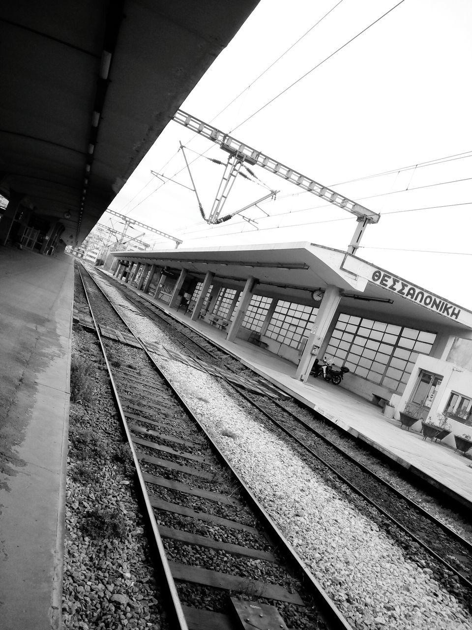 railroad track, rail transportation, transportation, public transportation, railroad station, railroad station platform, train - vehicle, no people, day, outdoors