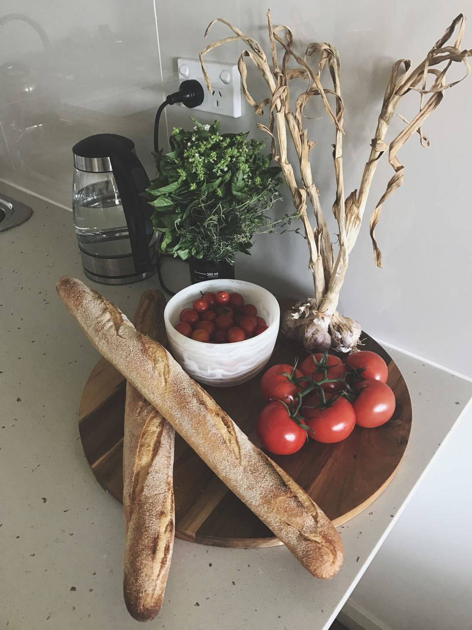 food, tomato, food and drink, freshness, table, vegetable, healthy eating, no people, herb, high angle view, indoors, cutting board, close-up, day