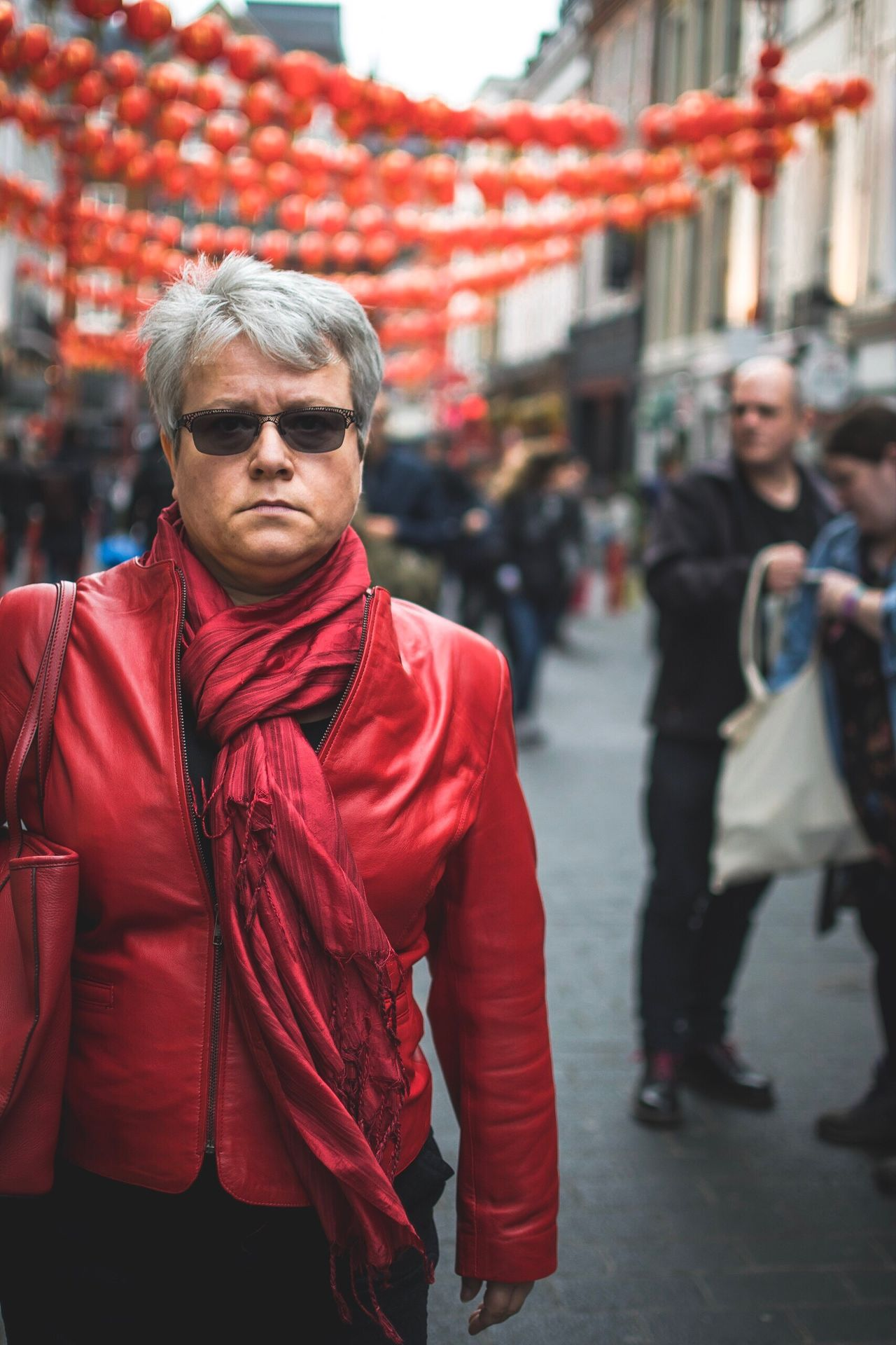 The Street Photographer - 2017 EyeEm Awards Lady in red Chinatown London Red Front View Real People Walking Outdoors One Person Lifestyles Focus On Foreground Day Looking At Camera Portrait Close-up Streetphotography Street Photography People