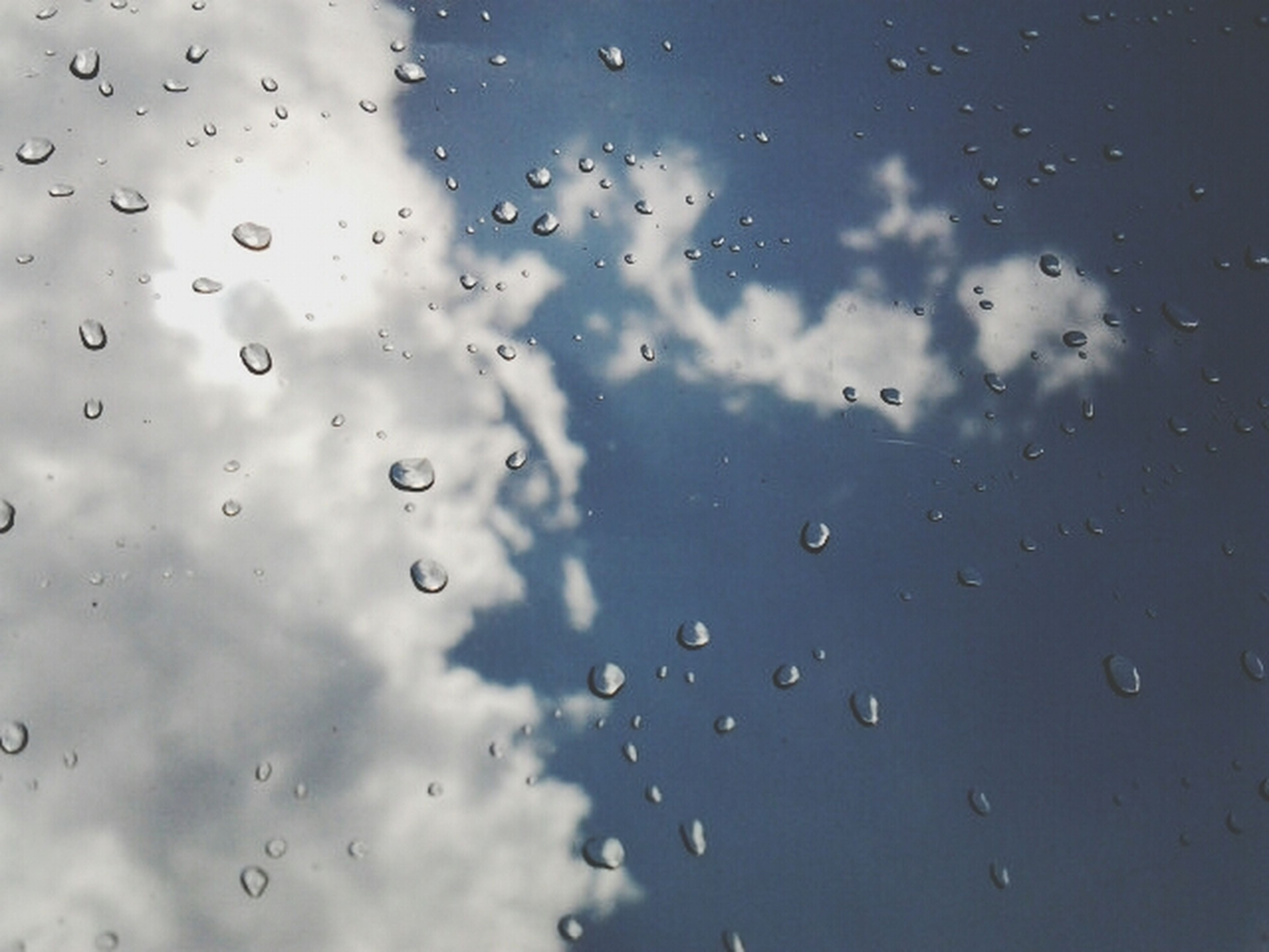 drop, wet, window, transparent, water, full frame, backgrounds, sky, rain, indoors, glass - material, weather, raindrop, cloud - sky, focus on foreground, nature, glass, close-up, no people, low angle view