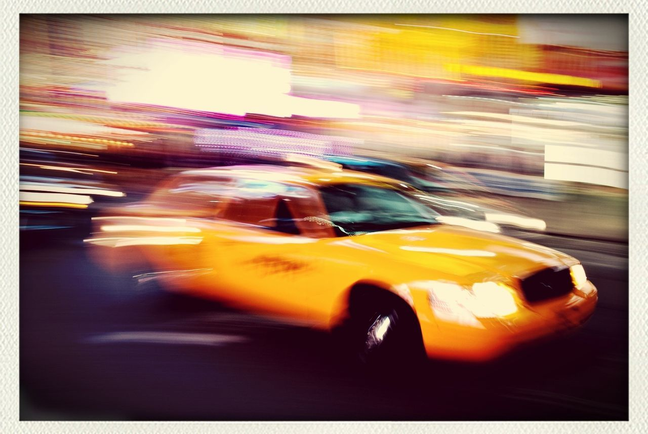 blurred motion, taxi, motion, car, speed, yellow taxi, yellow, transportation, city, city life, outdoors, illuminated, defocused, night, no people
