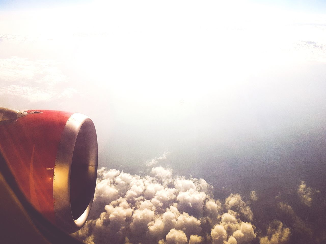 sky, nature, no people, cloud - sky, beauty in nature, day, air vehicle, scenics, airplane, jet engine, outdoors, airplane wing, close-up