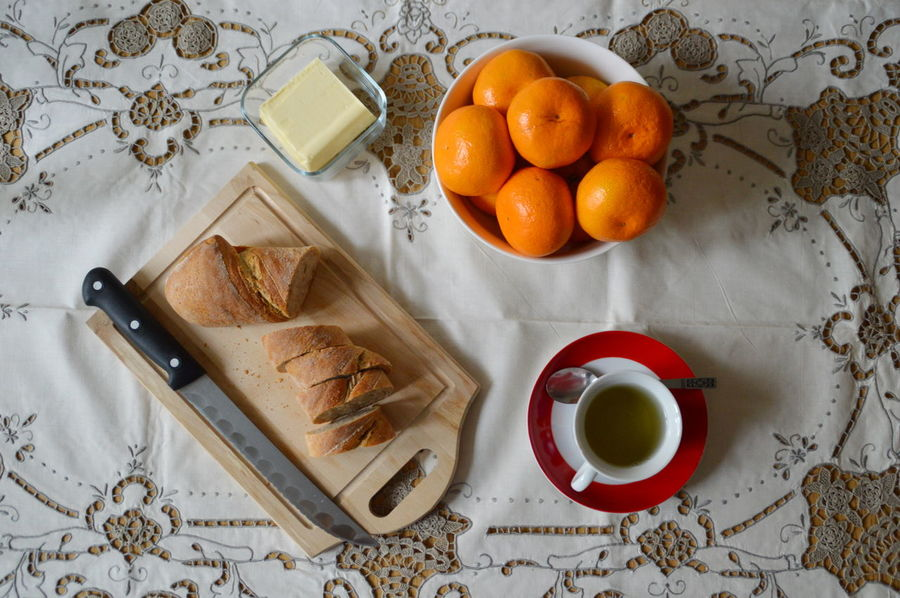 Bowl Breakfast Butter Cup Cup Of Tea Cutting Board Drink Food Food And Drink Freshness From Above  Indoors  Knife No People Ready-to-eat Tangerines Food Stories