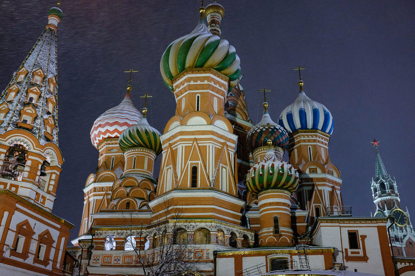 Low angle view of St Basil's cathedral at night in winter time Cold Weather Moscow St Basil's Cathedral Winter Architecture Building Exterior Built Structure Day Dome Domes Illuminated Low Angle View Night No People Outdoors Place Of Worship Religion Sculpture Sky Snow Spirituality Statue Travel Destinations