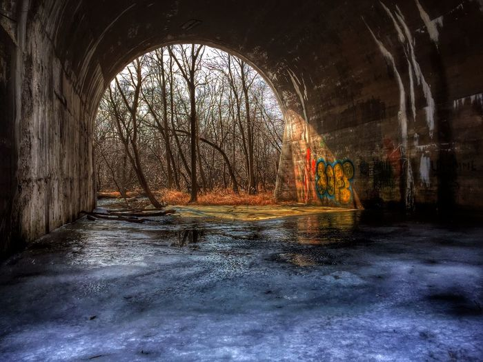 The same place as the graffiti wall, in early spring. A cloudy day gives diffused light for a well lite, lower contrast image and I love it! Rural Scenes Colors Colorful Sky And Trees Ice Arches Ice Blue IPSWebsite