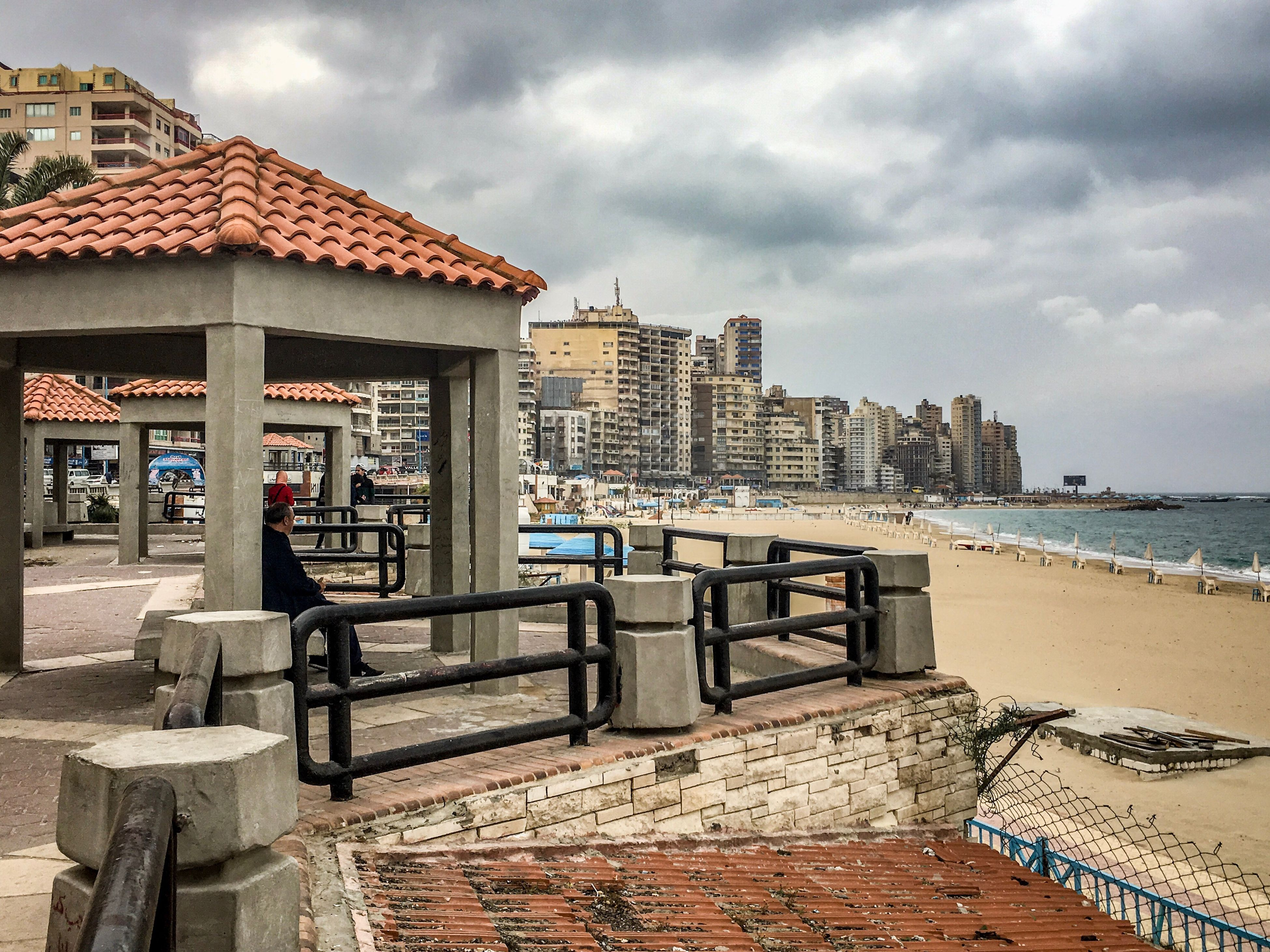 sky, cloud - sky, built structure, architecture, building exterior, city, outdoors, sunlight, day, sea, no people, beach, water, nature