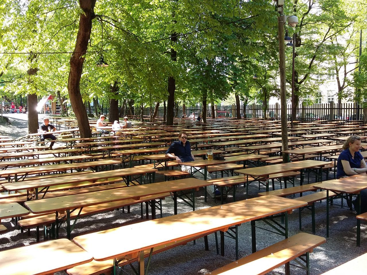 Waiting at the biergarten. · Munich München germany Augustiner August beer garden benches many benches Benches all around bench paradise summer Early Bird The Purist (no edit, no filter)