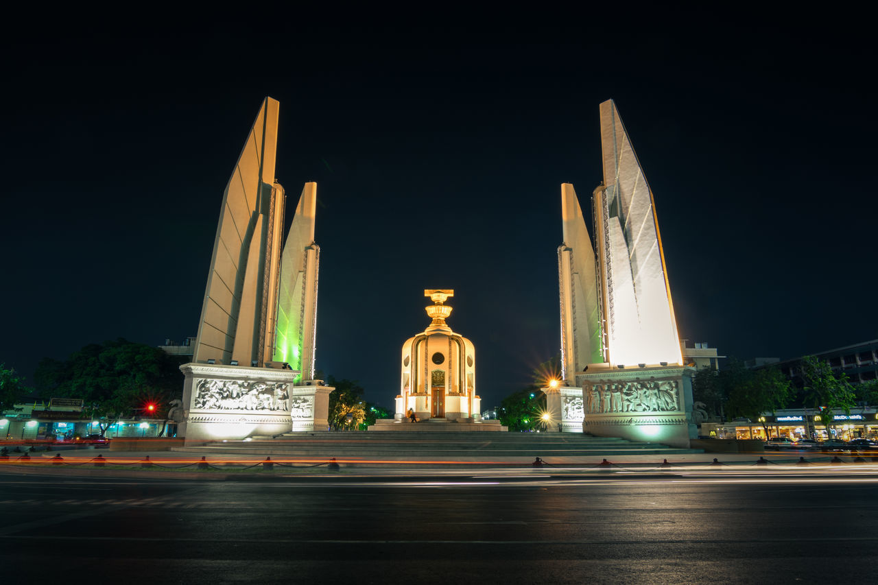 Democracy Monument in Bangkok , Thailand Architecture Bangkok Built Structure Capital Cities  City City Life Culture Democracy Monument Façade Famous Place Illuminated International Landmark Light Trail Night No People Outdoors Road Sky Thailand The Way Forward Tourism Travel Destinations