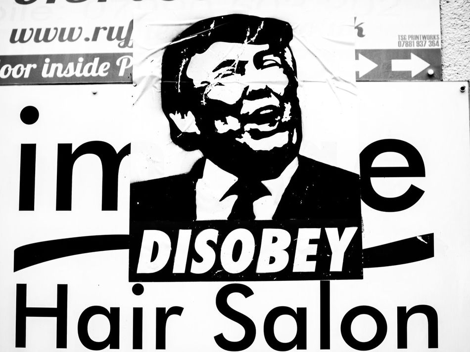 DISOBEY Adult Adults Only Black And White Photography Blackandwhite Photography Graffiti Graffiti Art Human Body Part Men Monochrome Monochrome Photography One Man Only People Politics POTUS President Street Photography Streetphoto_bw Streetphotography Text Trump Protest