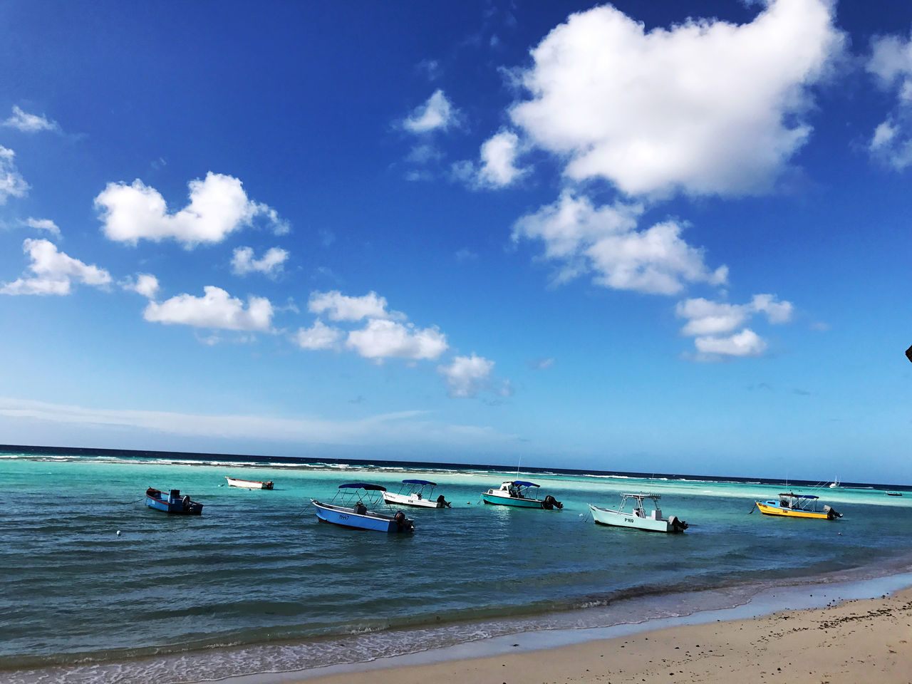 sea, beach, water, sky, beauty in nature, horizon over water, scenics, nature, tranquil scene, sand, nautical vessel, tranquility, cloud - sky, day, transportation, blue, outdoors, no people, jet boat, outrigger