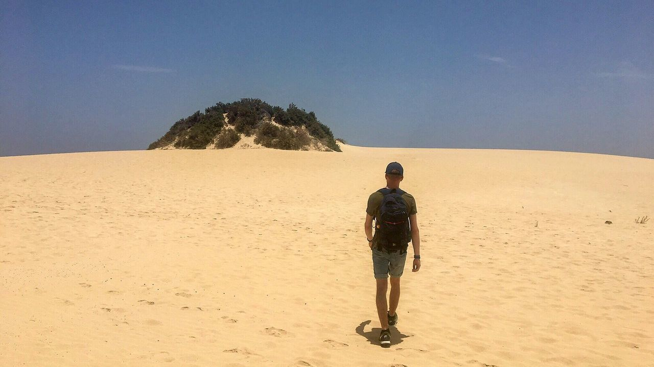 Sand Real People Nature Rear View Full Length Clear Sky Beauty In Nature Walking Scenics Standing Men One Person Sky Arid Climate Outdoors Beach Landscape Leisure Activity Tranquil Scene Day Fuerteventura Corralejo Dunes https://www.instagram.com/lucas_woerle/
