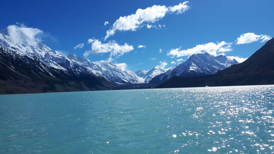 EyeEm Selects Mountain Blue Scenics Nature Water Outdoors Beauty In Nature Snow Mountain Range No People Sea Day Landscape Sky UnderSea New Zealand National Park Mt Cook, New Zealand Glaciers Tasman Lake Clear Sky Horizon Over Water Lake Tranquility