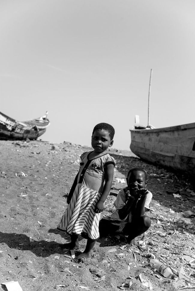 Africa Collection: West Africa, Ghana, Accra, Jamestown, fishermen village and children of fishermen captured in their own playground between their parents'boats Africa African Beach Boats Canoe Children Children's Portraits Enjoying Fishermen Kids Natural Playing Portrait Portraitist - 2016 Eyeem Awards Portraitist-2016 Eyeem Awards Sand Sandy Beach Sea Young Youth