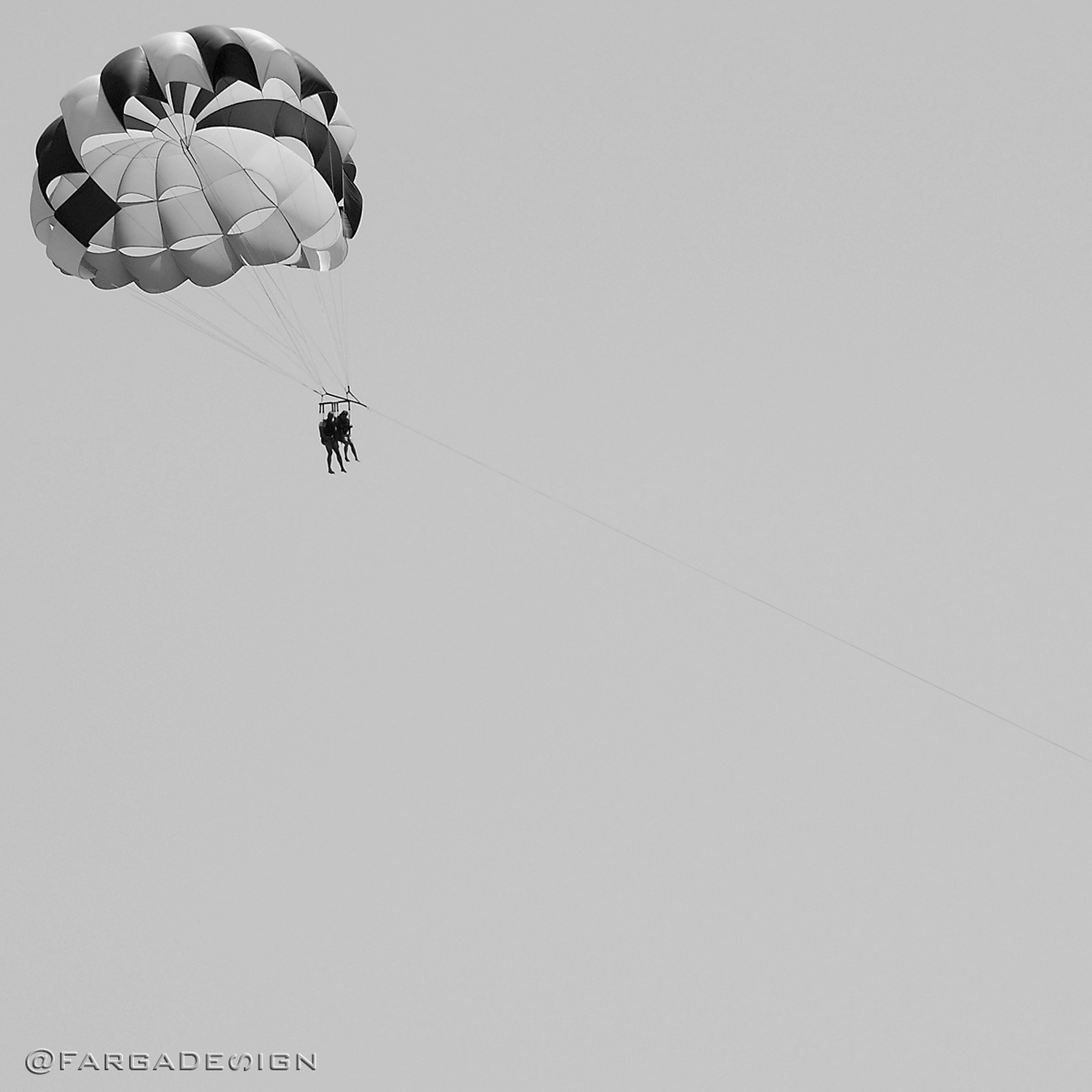transportation, mid-air, flying, extreme sports, mode of transport, adventure, low angle view, air vehicle, leisure activity, parachute, lifestyles, clear sky, airplane, on the move, copy space, travel, unrecognizable person, men
