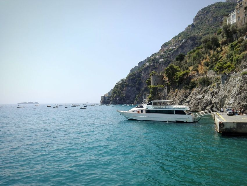 Nautical Vessel Transportation Boat Water Sea Waterfront Mountain Mode Of Transport Clear Sky Copy Space Calm Tranquil Scene Rippled Tranquility Scenics Nature Beauty In Nature Day Blue Outdoors Amalfi Coast Italy