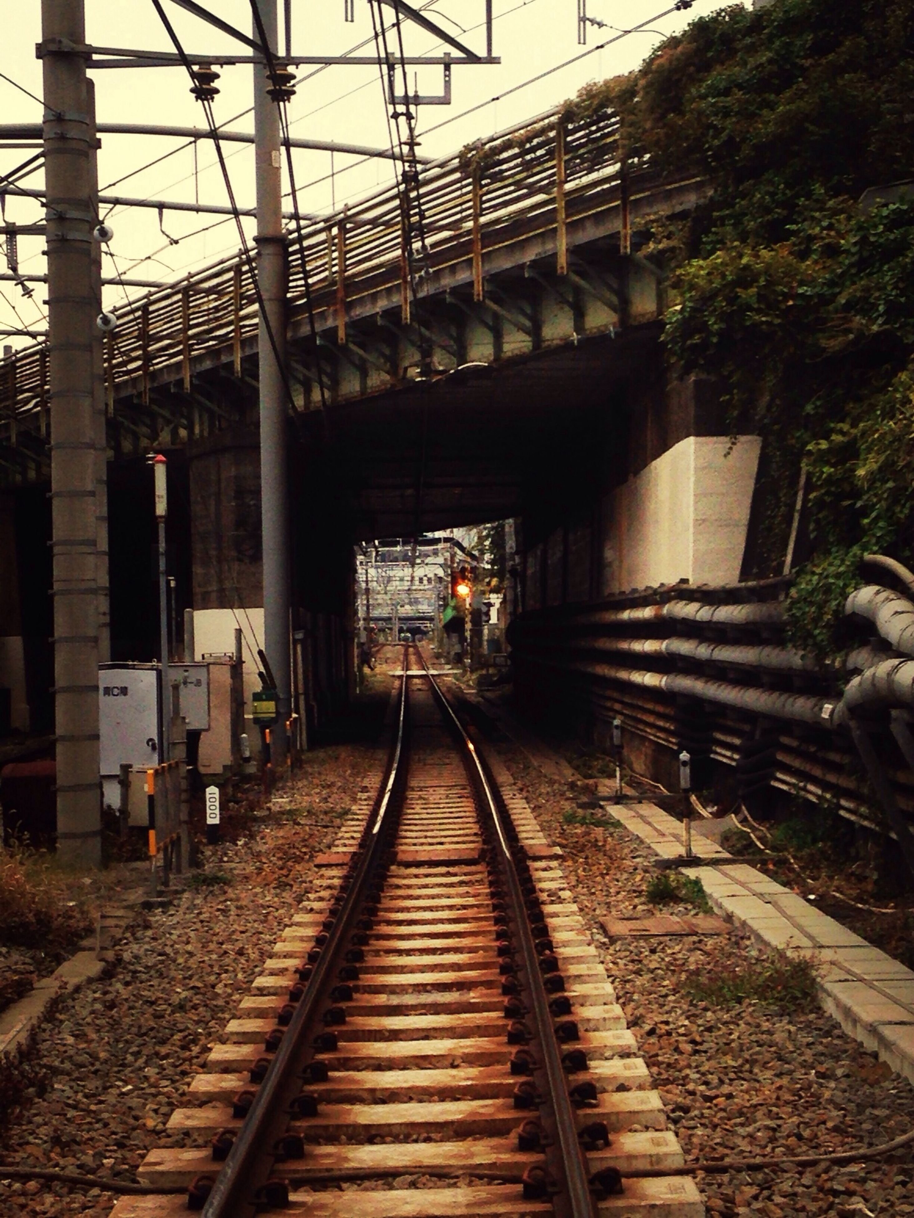 railroad track, the way forward, rail transportation, transportation, diminishing perspective, built structure, architecture, vanishing point, public transportation, railroad station platform, railroad station, railway track, long, connection, sky, building exterior, day, no people, outdoors, straight