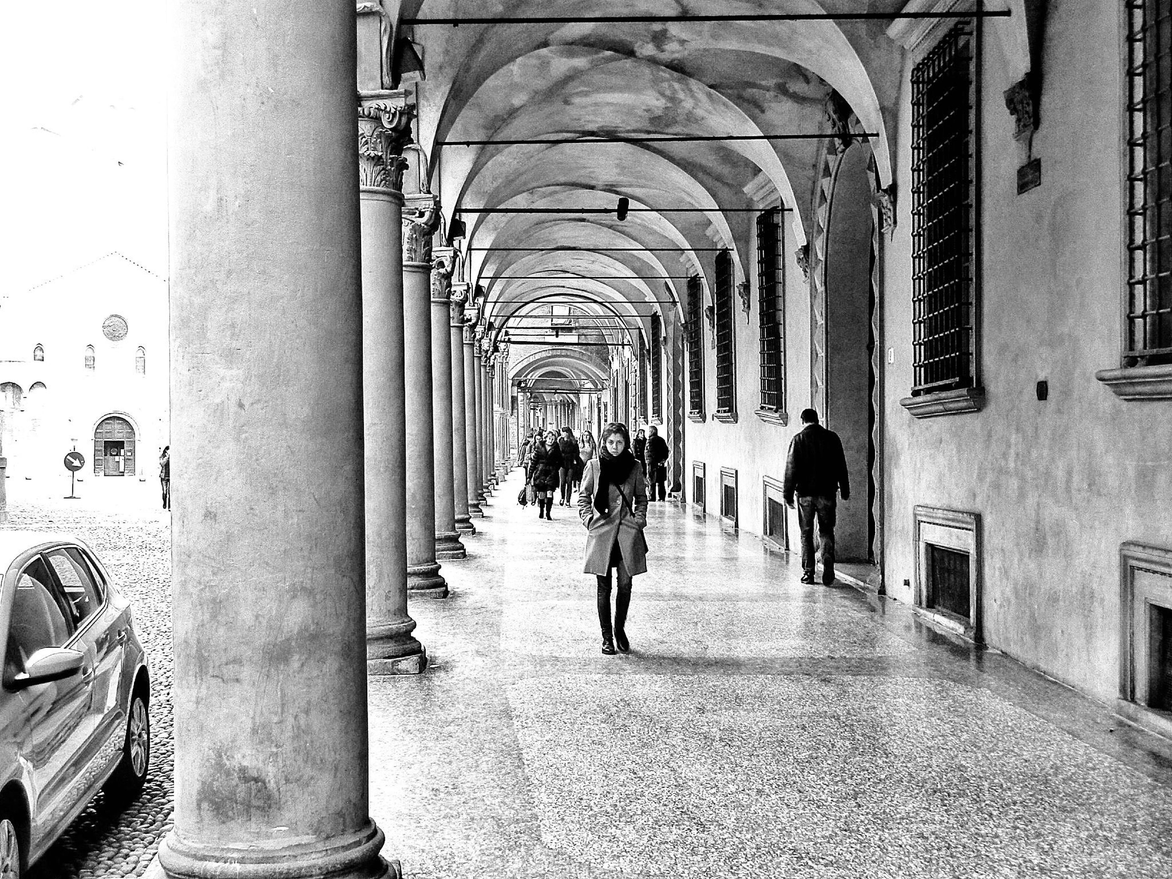 architecture, built structure, building exterior, arch, men, walking, the way forward, indoors, person, street, building, lifestyles, city, large group of people, diminishing perspective, incidental people, day, city life, leisure activity