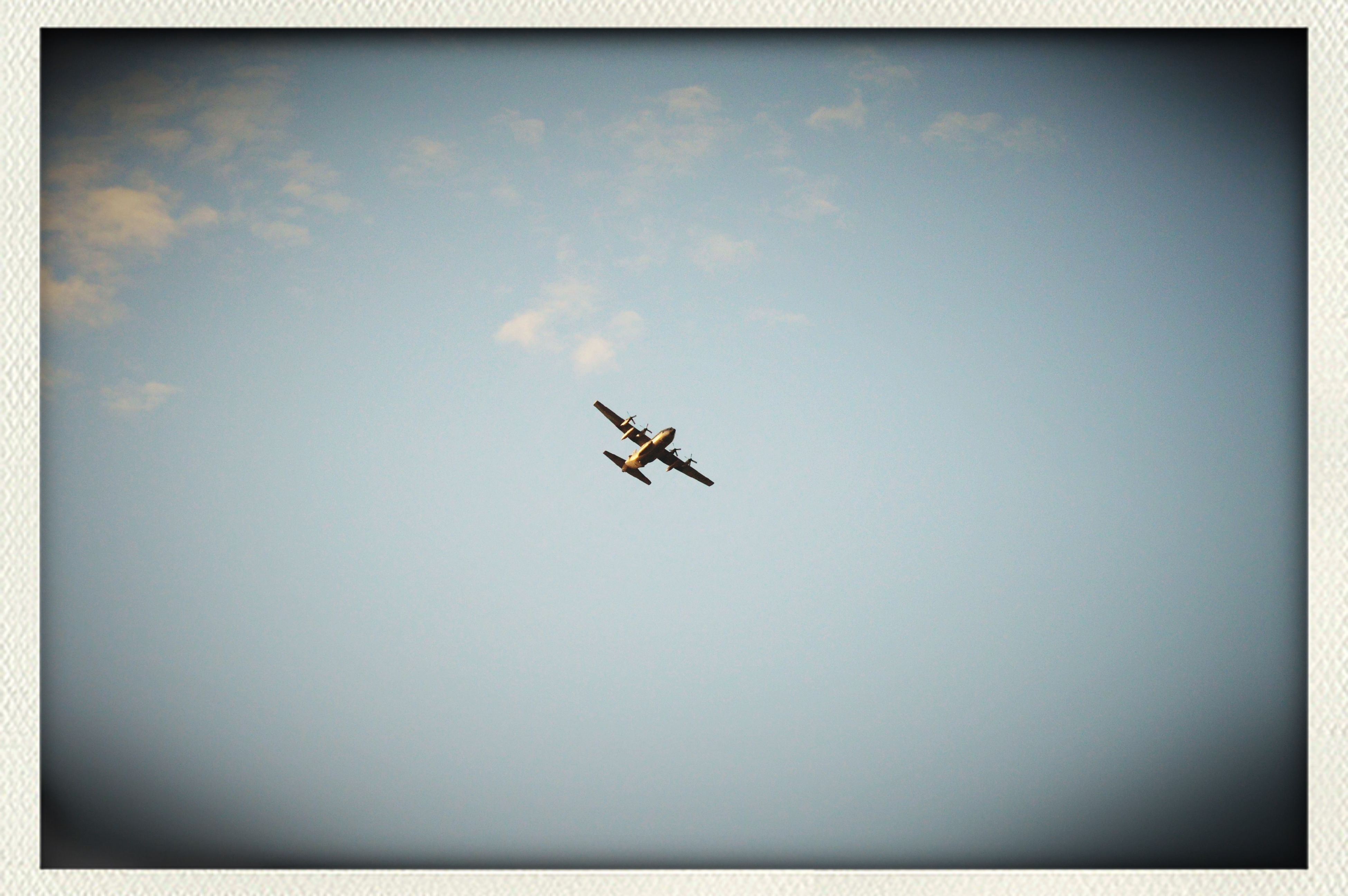 flying, airplane, air vehicle, transportation, transfer print, mode of transport, mid-air, auto post production filter, low angle view, sky, copy space, on the move, silhouette, journey, travel, blue, nature, cloud - sky, outdoors, vignette