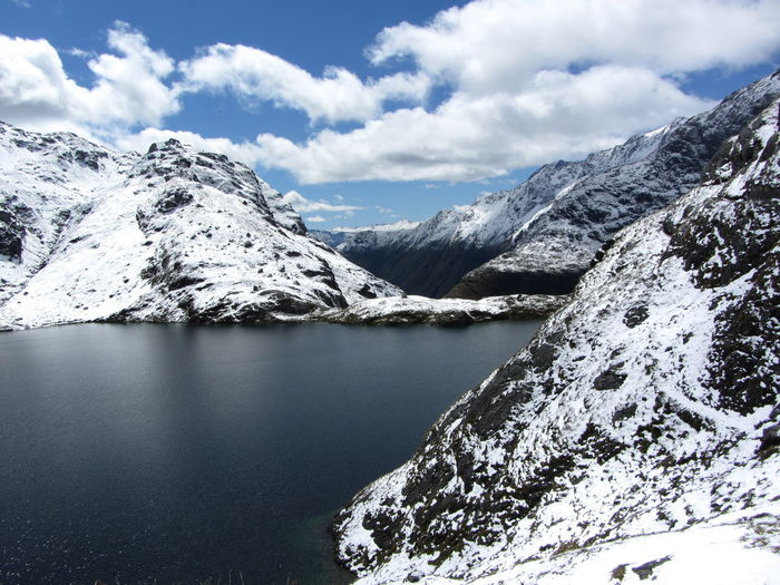 Beauty In Nature Cold Temperature Day Frozen Great Walk Ice Lake Landscape Mountain Mountain Range Nature New Zealand No People Outdoors Routeburn Track Scenics Sky Snow Snowcapped Mountain Tranquil Scene Tranquility Water Waterfront Wilderness Winter