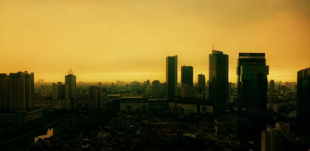 cityscape, architecture, skyscraper, city, building exterior, modern, sunset, built structure, no people, sky, urban skyline, travel destinations, outdoors, day