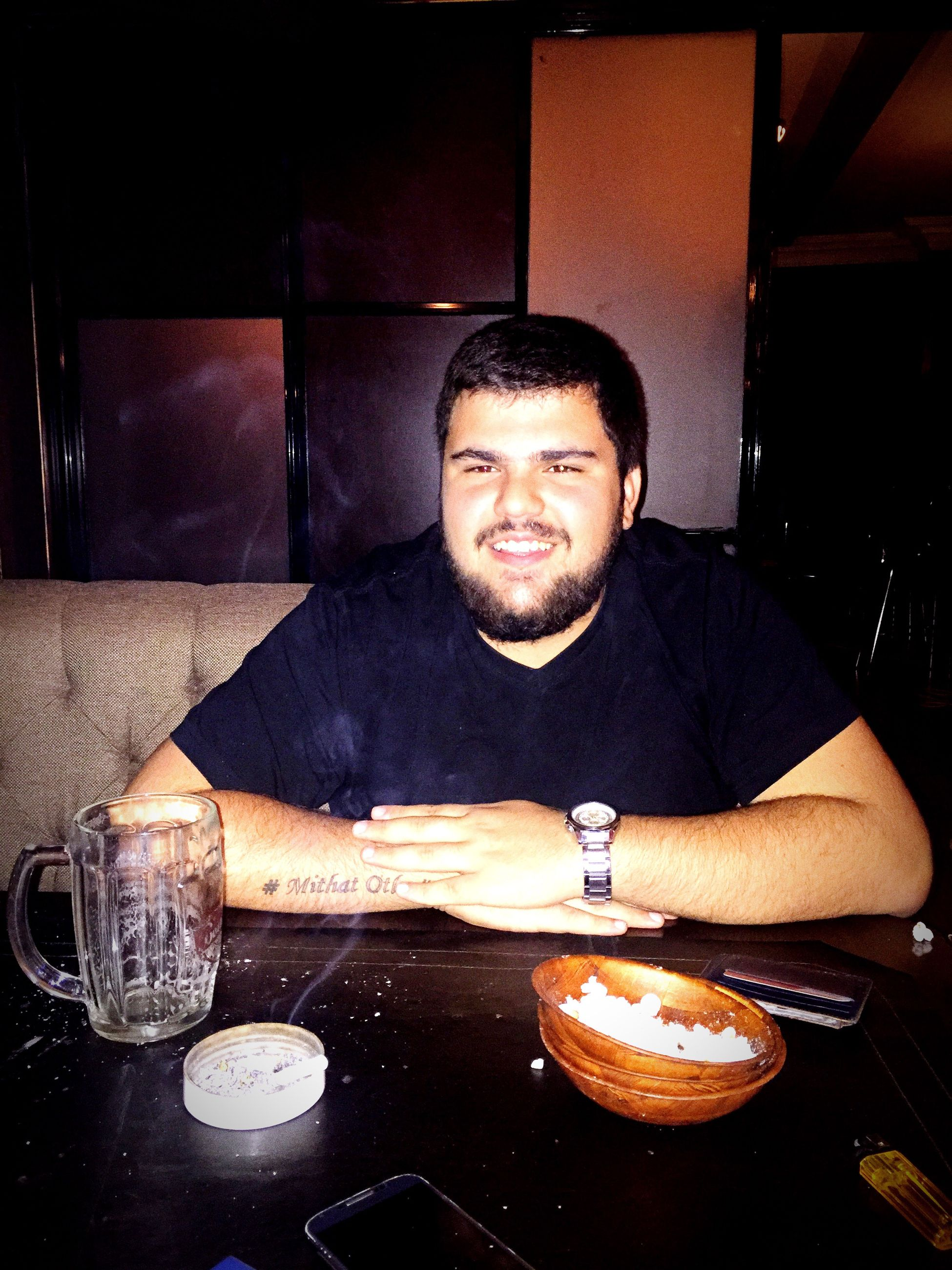 sitting, indoors, food and drink, illuminated, freshness, front view, looking at camera, casual clothing, person, young adult