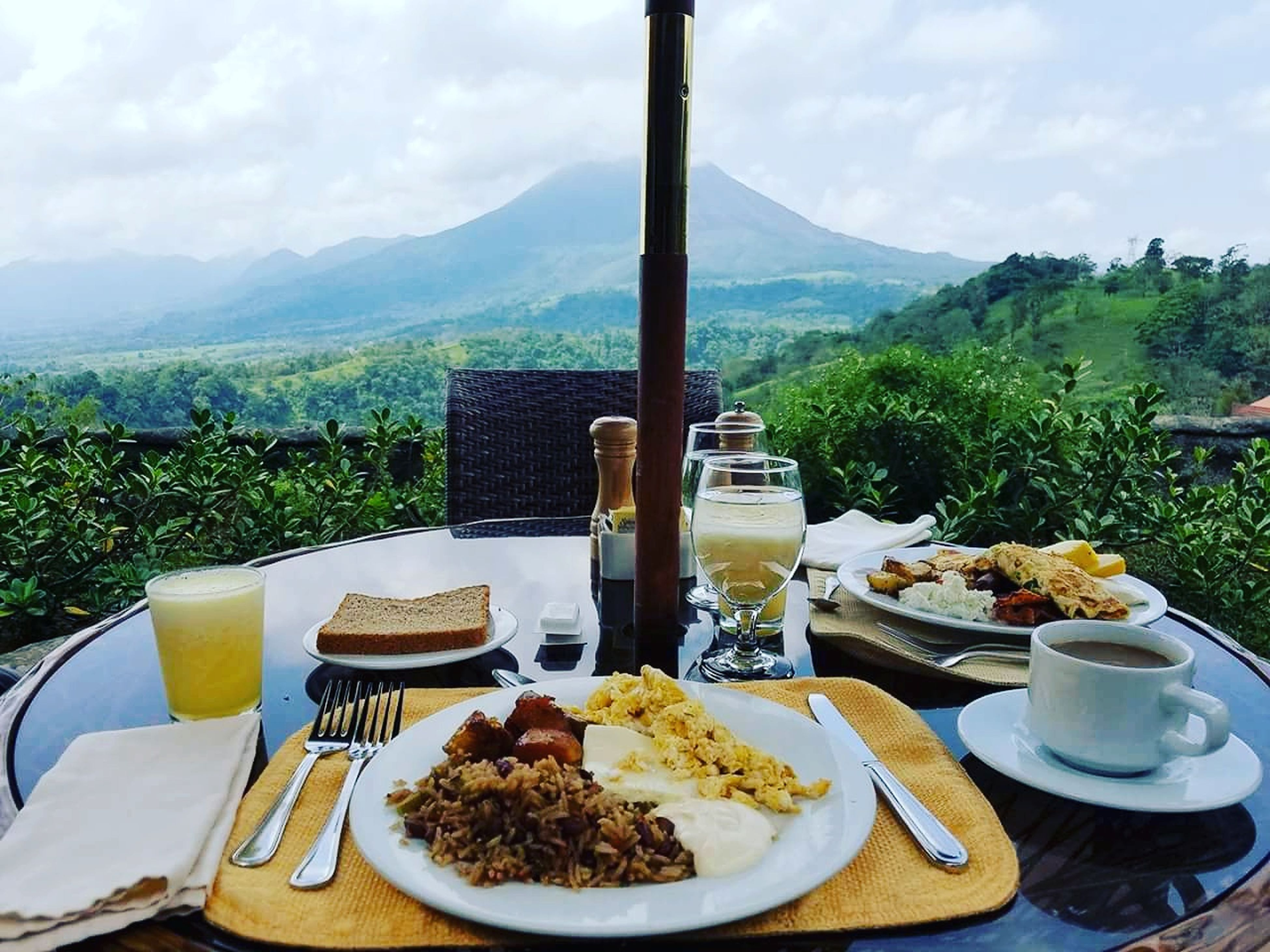 plate, food and drink, mountain, food, table, no people, freshness, day, serving size, mountain range, sky, ready-to-eat, tree, drink, outdoors, drinking glass, sweet food, temptation, landscape, healthy eating, nature, close-up