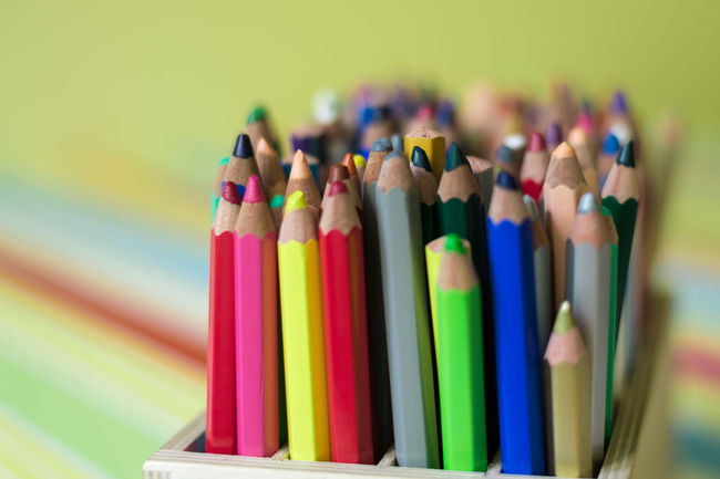 Box with lots of colored crayons in a classroom in a primary school. Classroom Close-up Collection Colorful Coloring Pencils Crayons Focus On Foreground Group Multi Colored No People School Still Life The Color Of School Variation
