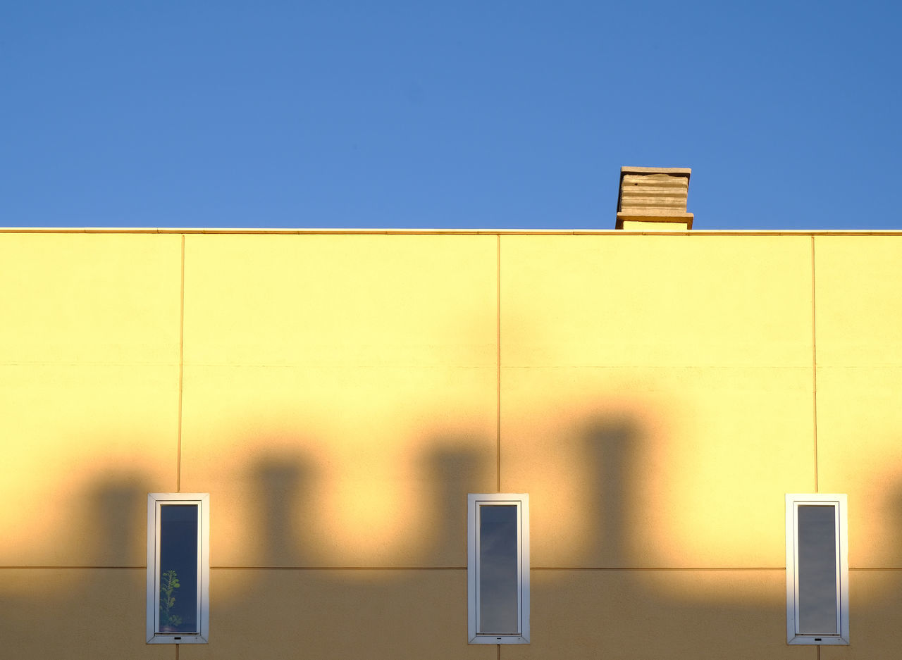 Architecture Blue Building Exterior Built Structure Chimney City Clear Sky Close-up Day Horizontal Symmetry Lines And Patterns Minimalism Minimalistic Modern Architecture No People Outdoors Shadows & Lights Sky Sunny Day Sunshine Symmetrical Three Windows Torremolinos Yellow Wall