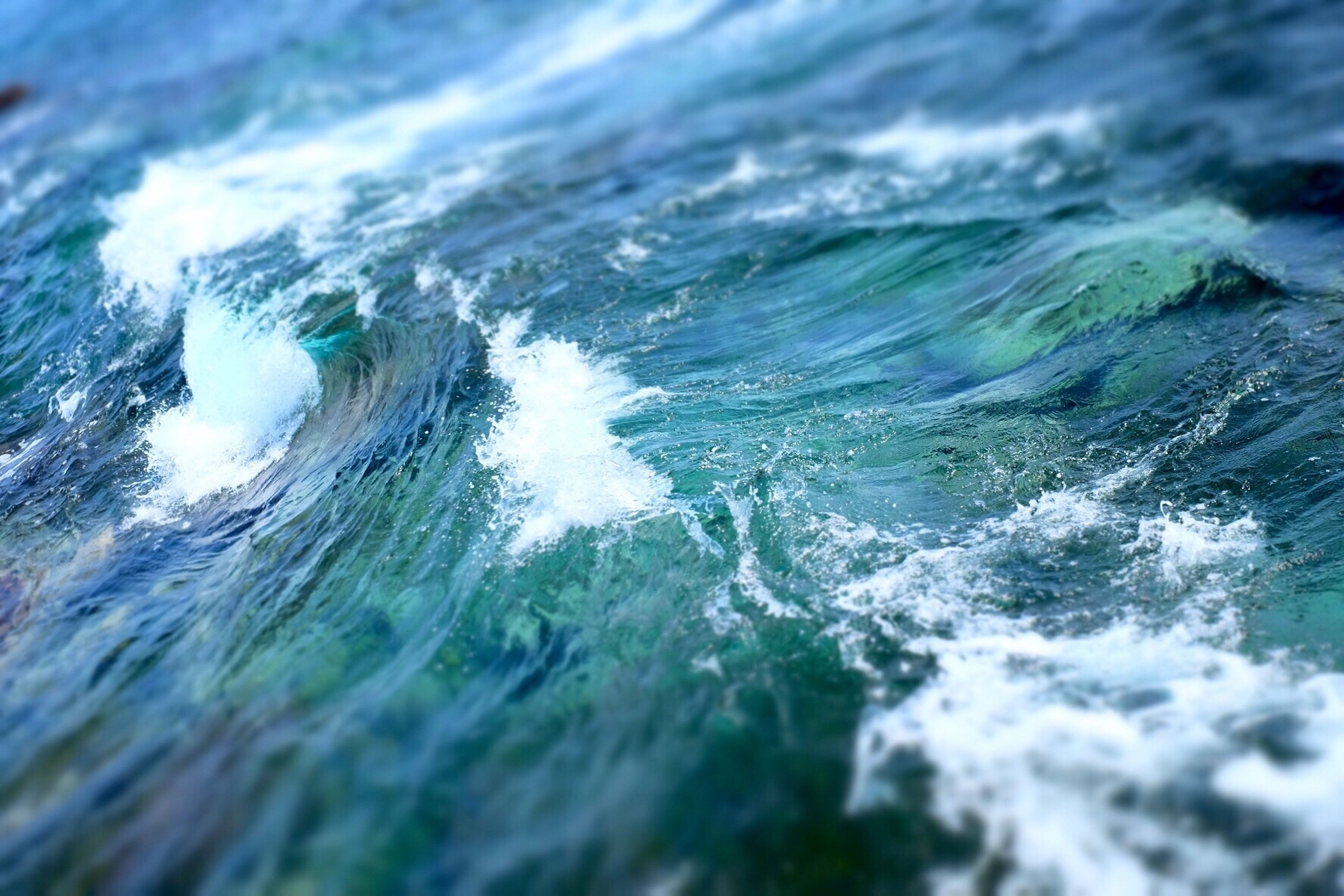 water, sea, waterfront, beauty in nature, wave, motion, nature, rippled, scenics, surf, splashing, tranquility, power in nature, tranquil scene, day, outdoors, high angle view, idyllic, no people, close-up