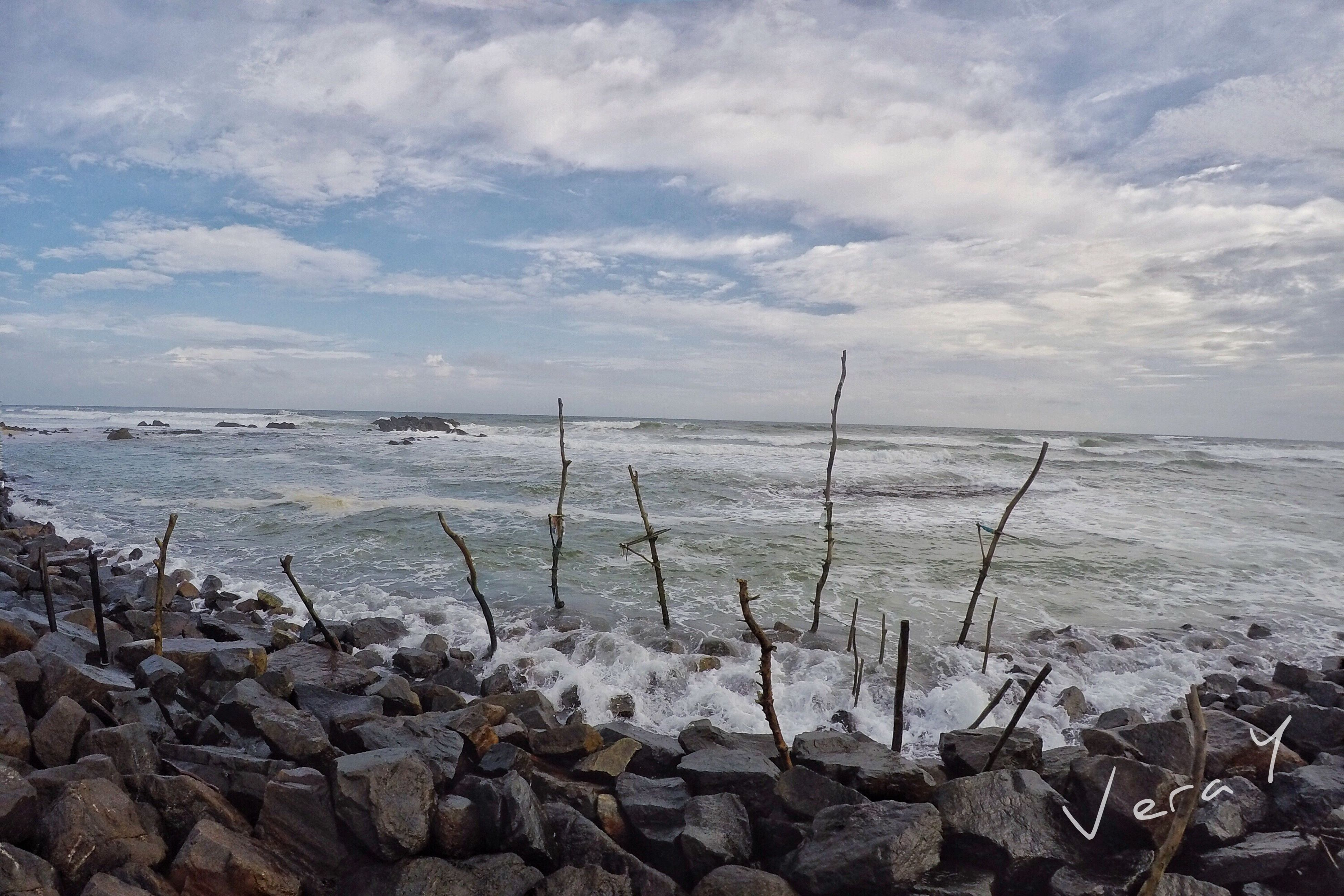 water, sky, sea, tranquility, tranquil scene, horizon over water, scenics, beauty in nature, cloud - sky, nature, rock - object, shore, stone - object, beach, cloudy, cloud, idyllic, lake, plant, remote