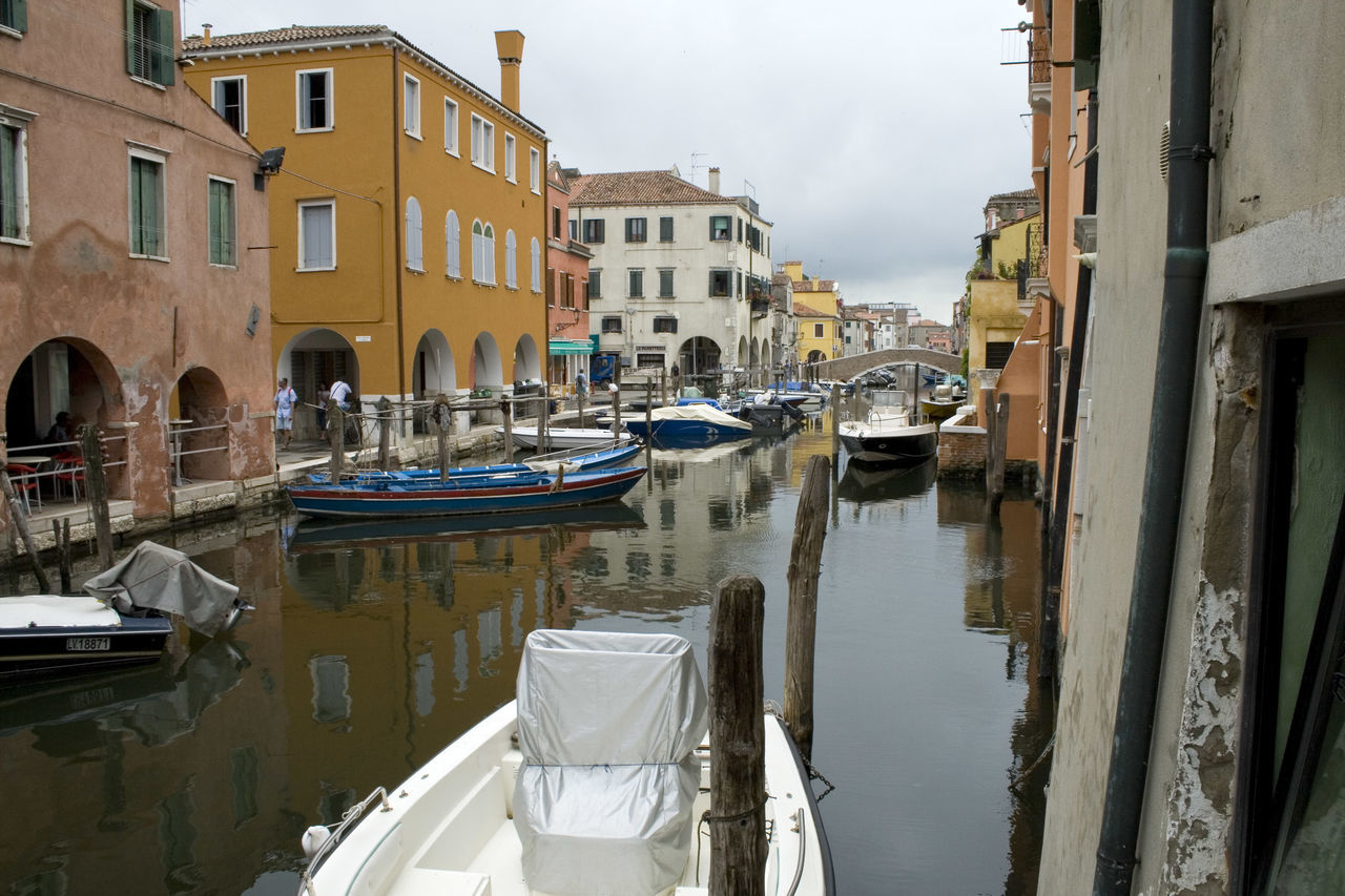 boats moored at canal Architecture Building Exterior Canal Chioggia, Italy City Cloud - Sky Day Gondola - Traditional Boat Mode Of Transport Moored Nautical Vessel No People Outdoors Reflection Sky Transportation Travel Destinations Water