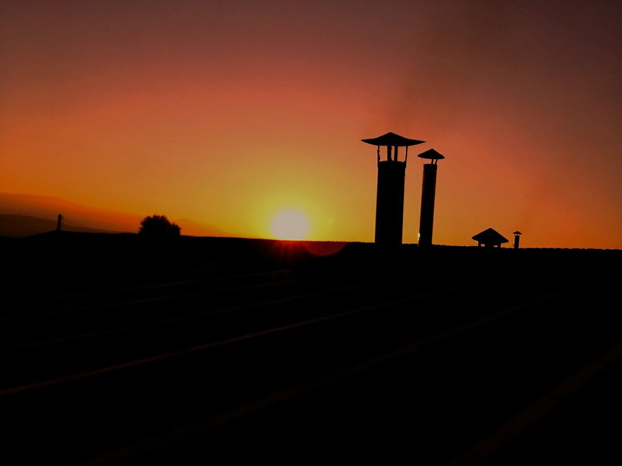 sunset, silhouette, orange color, sun, sky, tranquility, nature, no people, landscape, scenics, outdoors, beauty in nature, animal themes, day