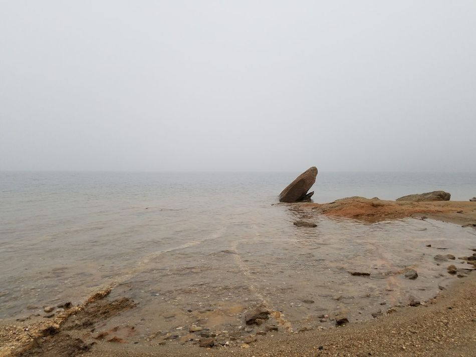 Fogrise over lake lanier. Outdoors Nature Sand Water Beauty In Nature Fog Foggy Landscape Fog Collection Lake One Boy Rear View