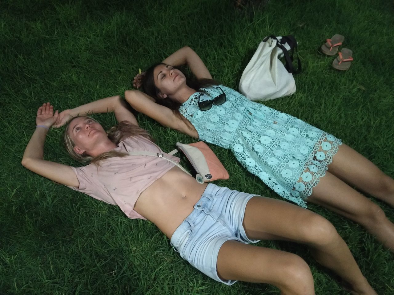 Two Young Women Relaxing On Grass