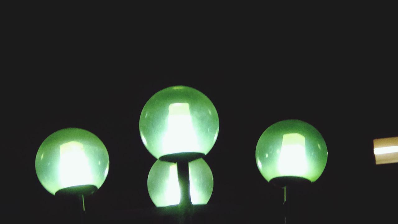 green color, illuminated, night, lighting equipment, no people, close-up, studio shot, black background, outdoors