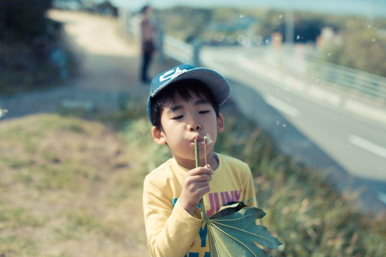 Beautiful stock photos of boy, Asian And Indian Ethnicities, Blowing, Boys, Cap
