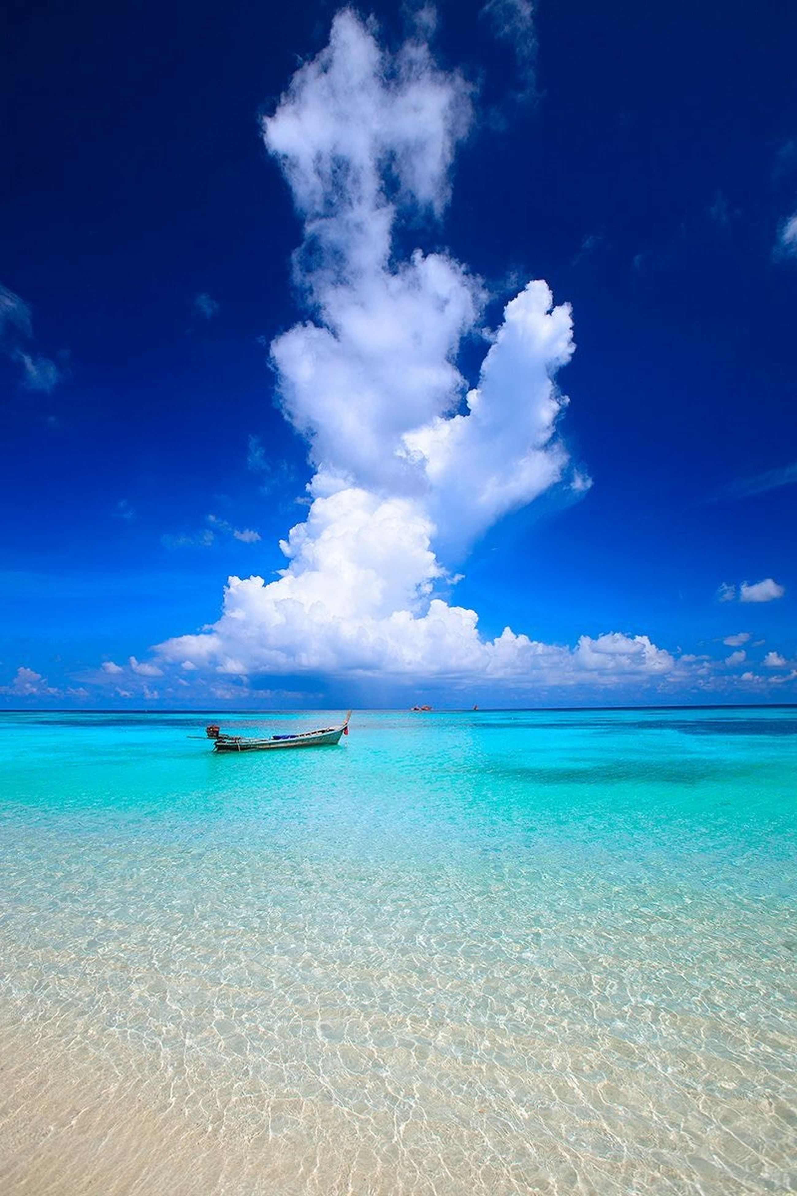 sea, water, blue, horizon over water, beach, tranquil scene, sky, tranquility, scenics, beauty in nature, shore, sand, nature, cloud, idyllic, cloud - sky, seascape, calm, coastline, vacations