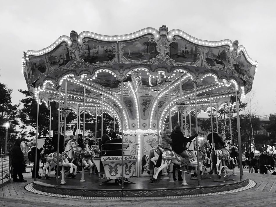 Carousel Amusement Park Ride Amusement Park Day Outdoors Kids Playing Leisure Activity Black And White Around The World Hanging Around
