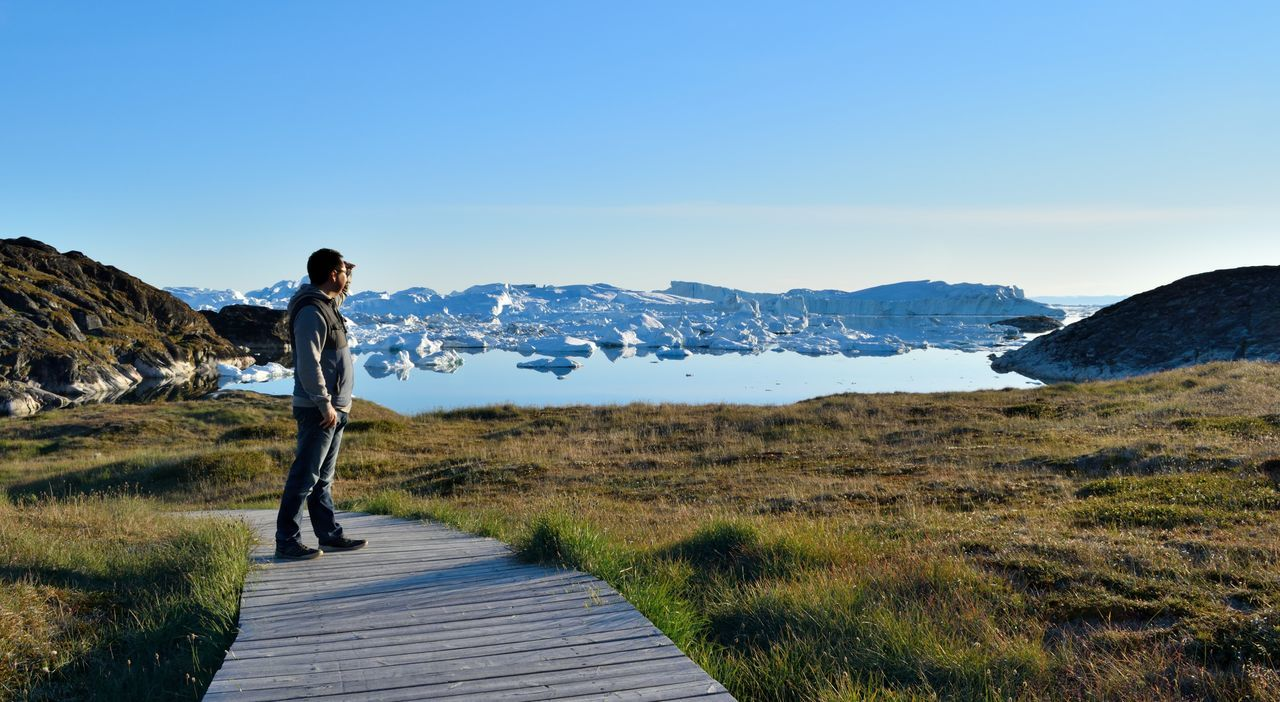 Photo taken by Ilulissat Icefiord, Greenland, at a Unesco world heritage site. A place of icebergs and serenity, home of the Inuit people. Adventure Arctic Arctic Circle Beauty In Nature Blue Sky Clear Sky Discovery Exploration Greenland Greenland,ilulissat Hiking Ice Icebergs Landscape Nature One Person Outdoors Sea And Sky Sky Summer Tranquil Scene Unesco UNESCO World Heritage Site Unescoworldheritage Vacations