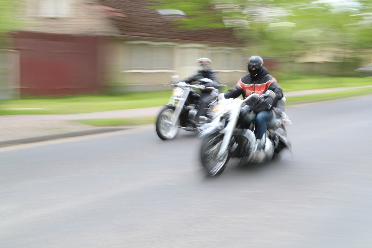 Adventure Biker Blurred Motion Day Headwear Helmet Land Vehicle Men Mode Of Transport Motion Motorcycle Motorcycle Racing Motorsport Outdoors Real People Riding Road Speed Sports Clothing Sports Race Transportation Two People