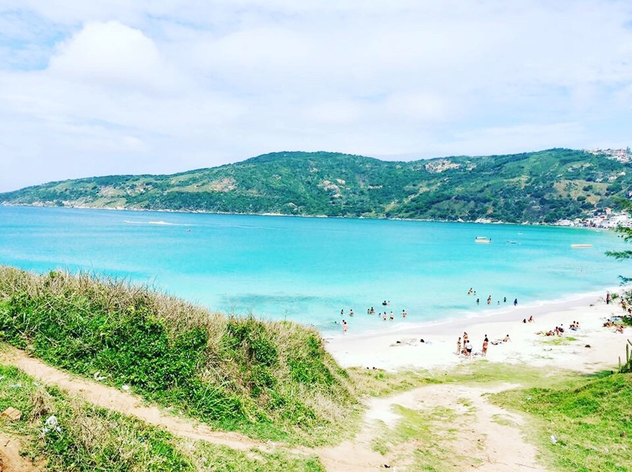 sea, scenics, beauty in nature, beach, water, nature, tranquility, tranquil scene, mountain, sky, sand, day, idyllic, cloud - sky, outdoors, horizon over water, vacations, grass, landscape, travel destinations, no people, tree