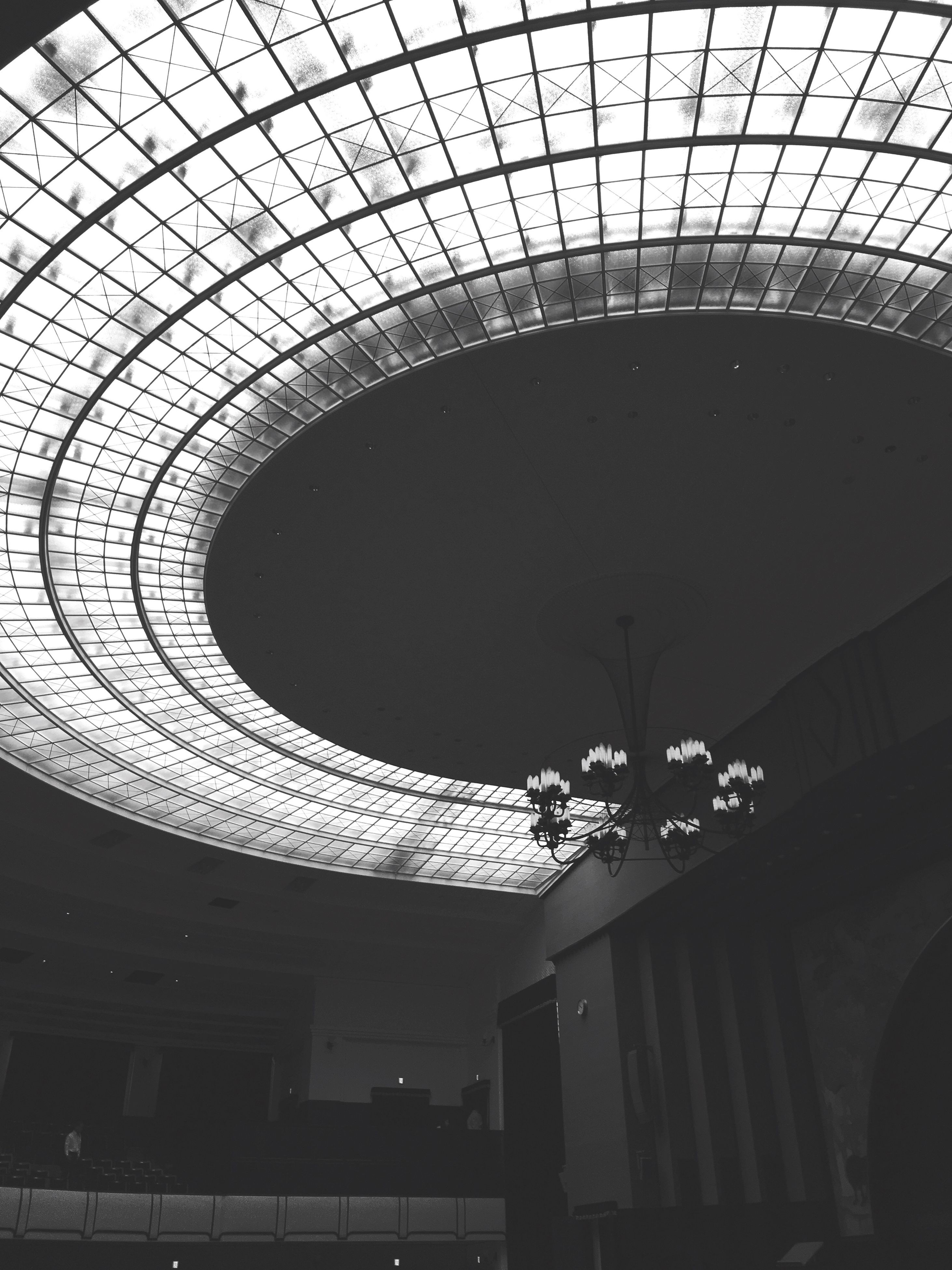 architecture, built structure, low angle view, ceiling, building exterior, indoors, arch, circle, illuminated, architectural feature, modern, building, skylight, pattern, directly below, design, no people, geometric shape, lighting equipment, sky