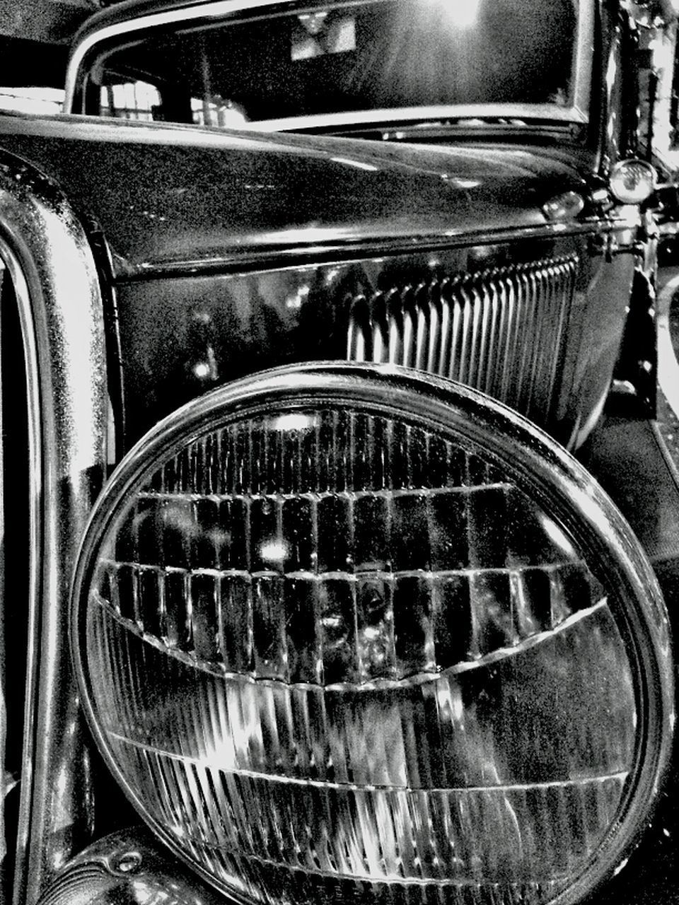 transportation, land vehicle, mode of transport, car, metal, old-fashioned, retro styled, old, vintage car, headlight, close-up, indoors, vehicle part, part of, metallic, machine part, travel, stationary, shiny, abandoned