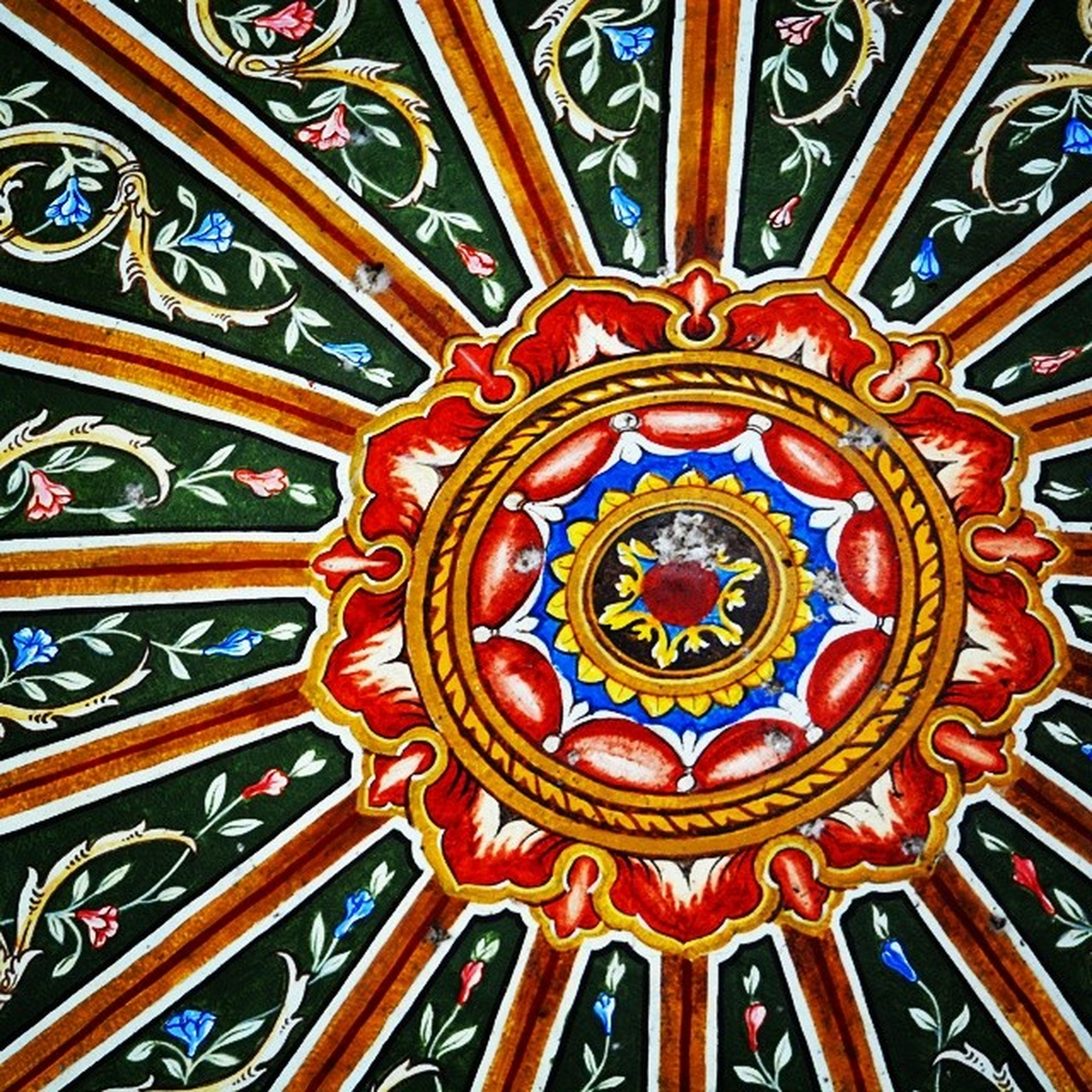 indoors, design, pattern, ceiling, ornate, art and craft, low angle view, art, creativity, multi colored, architecture, decoration, floral pattern, architectural feature, illuminated, full frame, backgrounds, built structure, directly below, stained glass