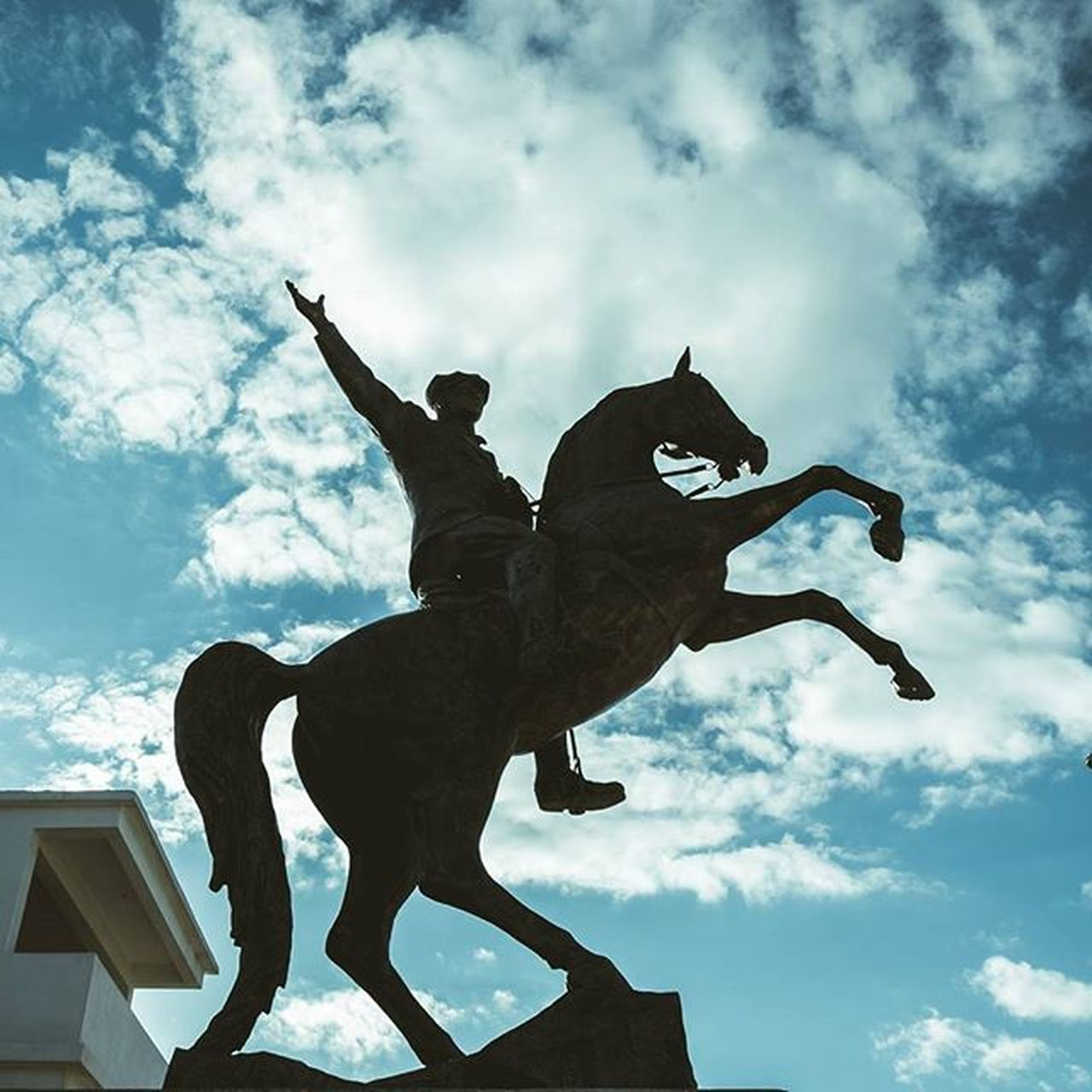 cloud - sky, sky, statue, sculpture, low angle view, art and craft, horse, human representation, day, outdoors, silhouette, architecture, building exterior, no people