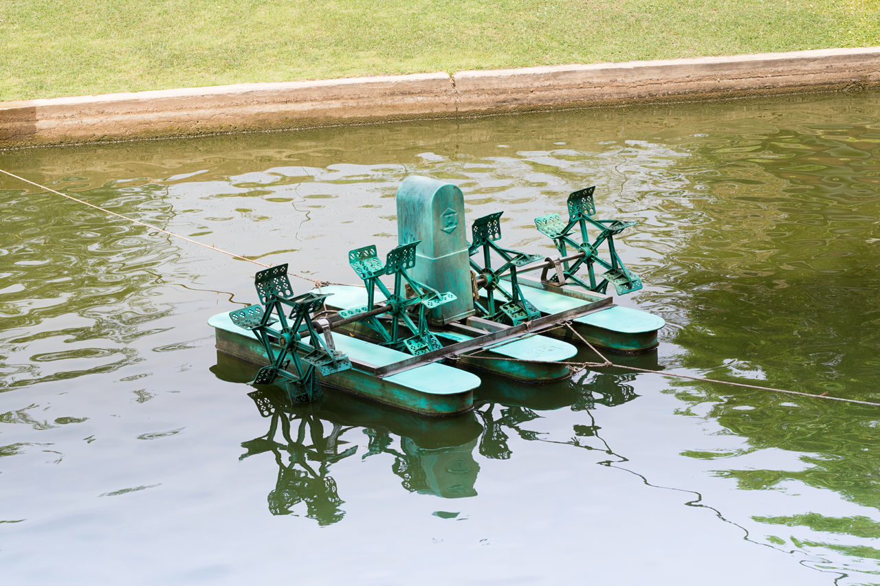 High Angle View Of Water Wheel In Lake