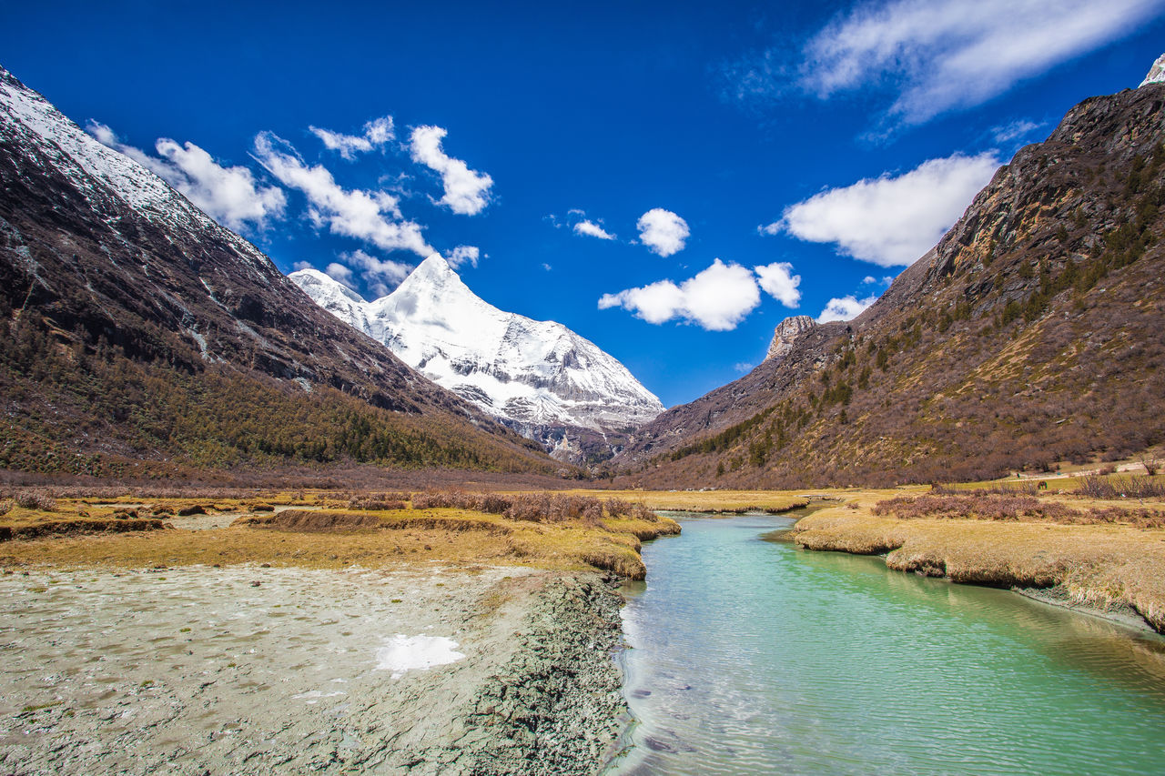Breathtaking scenery in Yading Nature Reserved, The sacred mountain in sunny day Autumn China Close-up Cloud - Sky Daocheng Day Landmark Landscape Landscape_Collection Mountain Mountain Range Nature No People Outdoors Reserve Scenery Scenery Shots Sichuan Sichuan Province Sky Snow Tranquility Wallpaper Yading Yunnan