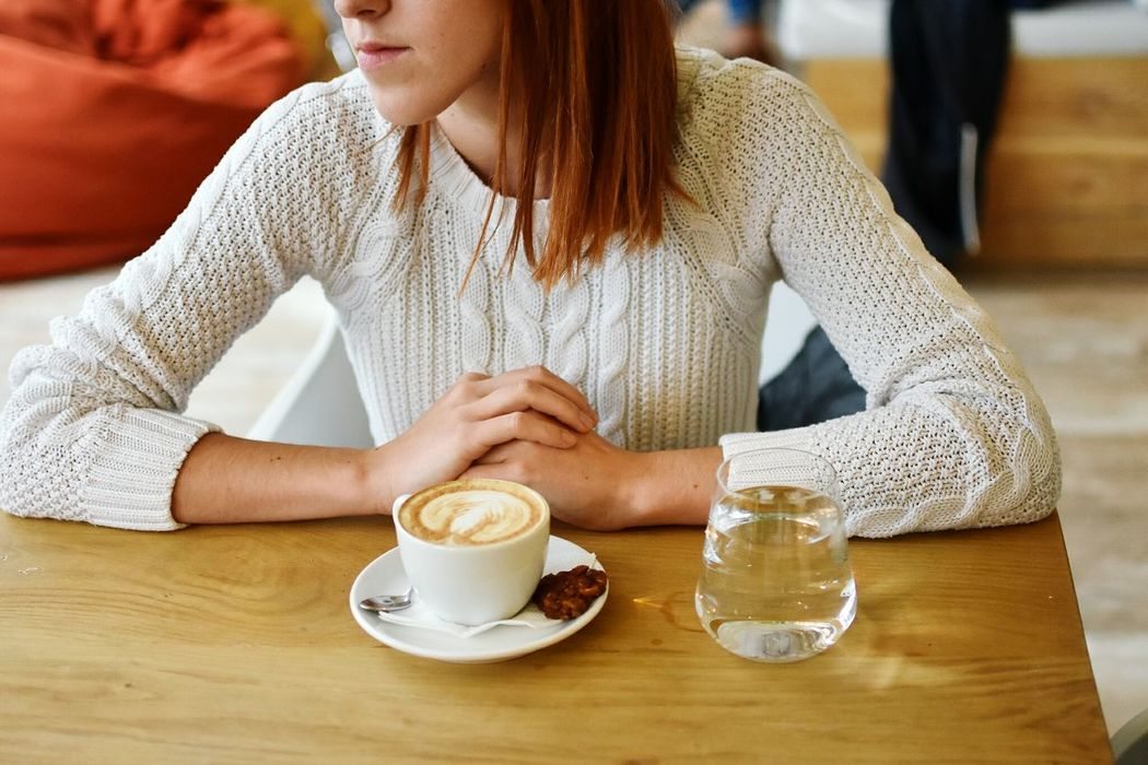 Coffee Cup Food And Drink Refreshment Drink Coffee - Drink Young Women Coffee Table Freshness Front View Casual Clothing Young Adult Mid Section Leisure Activity Focus On Foreground Beverage Long Hair Sitting Cafe Time Modernlifestyle Freckles Youngwomansitting Hanging Out Coffee Always Be Cozy